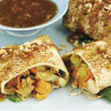 filipinos eat fresh spring rolls or lumpia in a wrapper that is gently ...